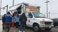 The Salvation Army hands out hot meals in Chicago.