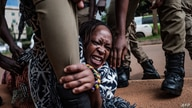 Stella Nyanzi, a prominent Ugandan activist and government critic, is arrested by police officers during coronavirus lockdown protests in Kampala, on May 18, 2020.