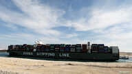 A container ship of China Shipping Line sails through the Suez Canal as Egypt celebrates the 150th anniversary of the canal…