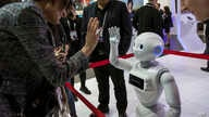 A XR-1 5G cloud robot by CloudMinds shakes hands with a visitor, during the Mobile World Congress wireless show, in Barcelona,…