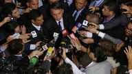 FILE - In this May 7, 2019 file photo, the press surrounds Brazil's President Jair Bolsonaro after he signed a second decree…