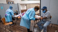 Registered nurses draw blood from patients during a COVID-19 antibody test drive at the Abyssinian Baptist Church, Thursday, May 14, 2020, in the Harlem neighborhood of the Manhattan.