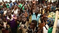 Newly arrived children refugees from the Democratic Republic of Congo (DRC) start singing before registration process at…