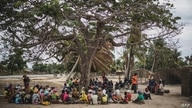 Residents gather for a meeting in the recently attacked village of Aldeia da Paz outside Macomia, on August 24, 2019. - On…