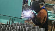 This photo taken on June 9, 2020 shows an employee working at a factory in Haian in China's eastern Jiangsu province. - China's…