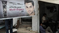 An advertising banner for Unilever product, Fair and Lovely skin fairness cream is displayed outside a shop in New Delhi on…