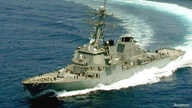The Arleigh Burke class destroyer USS Russell is shown in the Gulf ofOman in this May 23, 2000 file photo. A small boat from…