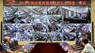 """Staff members monitor the venues as students sit for the annual national college entrance examination, or """"gaokao"""", in Xian,…"""