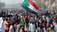Civilians gather as members of Sudanese pro-democracy protest on the anniversary of a major anti-military protest, as groups…