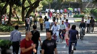 FILE - In this Jan. 11, 2013 file photo, employees of Infosys Technologies, the Indian technology outsourcing giant, move…