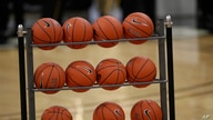 Basketballs sit in a rack in the first half of an NCAA college basketball game Thursday, Jan. 23, 2020, in Boulder, Colo. (AP…