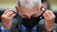 Director of the National Institute of Allergy and Infectious Diseases Dr. Anthony Fauci takes off his face mask before…