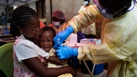 FILE - A child is vaccinated against Ebola, in Beni, Congo, July 13, 2019.