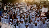 FILE - Pakistani religious students rally for the implementation of a blasphemy law and against the acquittal of Aasia Bibi, in Karachi, Pakistan, Nov. 21, 2018.