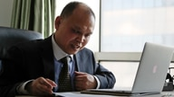 FILE - Chinese lawyer Yu Wensheng is seen working at his office in Beijing, Feb. 24, 2107.