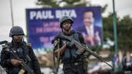 (FILES) In this file photo taken on October 03, 2018 Members of the Cameroonian Gendarmerie patrols in the Omar Bongo Square of…