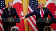 FILE PHOTO: U.S. President Donald Trump reaches to Turkey's President Tayyip Erdogan during a joint news conference at the…