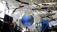 FILE PHOTO: A model of the BeiDou navigation satellites system is seen at an exhibition to mark China's Space Day 2019 on April…