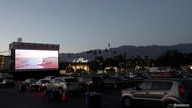 "People watch the movie ""Jaws"" at The Tribeca Drive-In outside Rose Bowl stadium during the outbreak of the coronavirus disease."