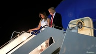 U.S. President Donald Trump and first lady Melania Trump descend from Air Force One following a trip from South Dakota, at Joint Base Andrews in Maryland, U.S., July 4, 2020.