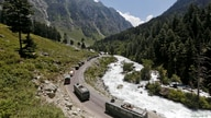 FILE PHOTO: An Indian Army convoy moves along a highway leading to Ladakh, at Gagangeer in Kashmir's Ganderbal district.