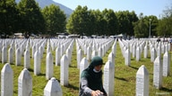 A woman is seen at a graveyard, ahead of a mass funeral in Potocari near Srebrenica, Bosnia and Herzegovina, July 11, 2020. Bosnia marks the 25th anniversary of the massacre of more than 8,000 Bosnian Muslim men and boys.