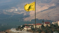 A Hezbollah flag flutters in the southern Lebanese village of Khiam, near the border with Israel, Lebanon July 28, 2020…