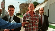 In this 1998 photo, Wesley Ira Purkey, center, is escorted by police officers in Kansas City, Kan., after he was arrested.