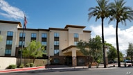 A Hampton Inn is shown, July 21, 2020 in Phoenix. The Trump administration is detaining immigrant children as young as 1 in hotels before deporting them to their home countries.