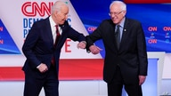 FILE - In this March 15, 2020, file photo, former Vice President Joe Biden, left, and Sen. Bernie Sanders, I-Vt., right, greet…
