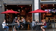People gather at the North Shore Tavern in Pittsburgh on Sunday, June 28, 2020. In response to the recent spike in COVID-19…