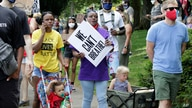 Katrina Hendricks, left, pushes a stroller holding her son, Melo, as her mother, Elaine Loving, walks alongside her at a Juneteenth rally and march through a historically Black neighborhood in Portland, Ore, June 19, 2020.