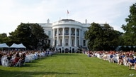 "Guests wait for President Donald Trump and first lady Melania Trump during a ""Salute to America"" event on the South Lawn of the White House, Saturday, July 4, 2020, in Washington. (AP Photo/Patrick Semansky)"