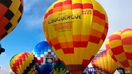 FILE - Hot air balloons are inflated during the annual Albuquerque International Balloon Fiesta in Albuquerque, N.M., Oct. 5, 2019.