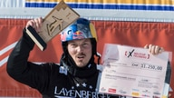 Winner Alex Pullin from Australia cheers at the snow boarding cross World Cup in Feldberg, Germany, Feb. 12, 2017. Two-time world snowboard champion and Winter Olympian Alex Pullin drowned on July 8, 2020, while spearfishing on Australia's Gold Coast.