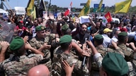 Hezbollah supporters scuffle with Lebanese army soldiers while protesting the visit by Gen. Frank McKenzie, the head of U.S. Central Command, outside the Rafik Hariri International Airport in Beirut, Lebanon, July 8, 2020.