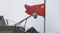 The flag of China flies behind a security camera over the Chinese Consulate in San Francisco, Thursday, July 23, 2020. The…