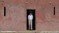 U.S. President Barack Obama looks down as he approaches the 'Door of No Return,' through which slaves once passed as they…