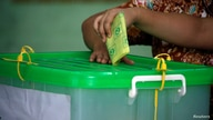 A voter cast her ballot for the by-election in Yangon, Myanmar,  November 3, 2018. REUTERS/Ann Wang