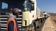 Wisiso Balathi tells of their frustrations despite the essential service truckers provide PIC (Mqondisi Dube/VOA)