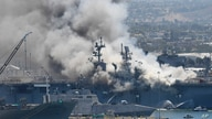Smoke rises from the USS Bonhomme Richard at Naval Base San Diego, July 12, 2020, in San Diego, Califonia, after an explosion and fire Sunday on board the ship.