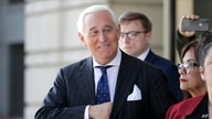 FILE - Roger Stone exits federal court in Washington,  Nov. 15, 2019.