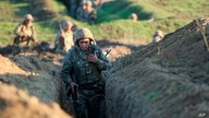 Armenian soldiers take their position on the front line in Tavush region, Armenia, July 14, 2020. Skirmishes on the volatile Armenia-Azerbaijan border escalated Tuesday, marking the most serious outbreak of hostilities between the neighbors since 2016.
