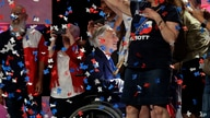 FILE - Confetti falls as Texas Gov. Greg Abbott, center, greets supporters after speaking at the Texas GOP Convention, in San Antonio, June 15, 2018.