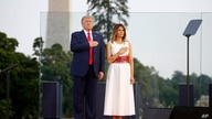 "President Donald Trump and first lady Melania Trump hold their hands over their hearts during a rendition of the national anthem as part of a ""Salute to America"" event, the South Lawn of the White House, in Washington, July 4, 2020."