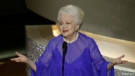 FILE - Actress Olivia de Havilland introduces fellow former Oscar winners as at the 75th Annual Academy Awards at the Kodak Theatre in Hollywood, California, March 23, 2003.