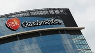 FILE - General view outside GlaxoSmithKline (GSK) headquarters in Brentford, Britain, May 4, 2020.