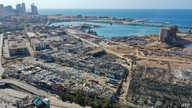 An aerial view shows the massive damage done to Beirut port's grain silos (C) and the area around it on August 5, 2020, one day…