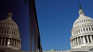 A plane flies across the sky beside the U.S. Capitol dome ahead of the House of Representatives  resolution appointing…