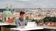 Joseph Petrila, a 23 years old job seeker, uses a laptop in a cafe near the Prague Castle following the coronavirus disease …